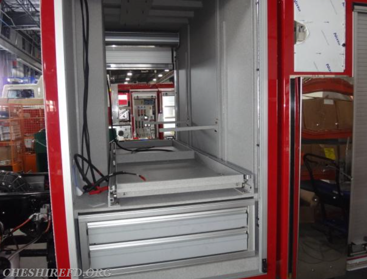 This is a view of the interior of the first compartment on the driver's side of the truck. Additional storage brackets for a stokes basket and ladder will be installed in this compartment shortly.