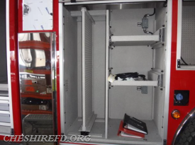 This is the second compartment on the driver's side and includes a sliding tool board and adjustable pull-out shelves.