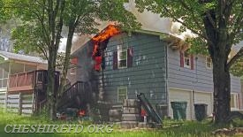 Fire quickly extended from the window and into the soffit and attic space above.
