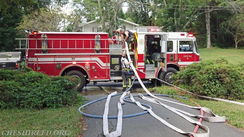 Cheshire Engine 6 positioned in the front of the residence and supplied several hose lines during the fire.