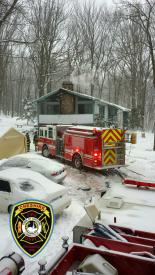 Due to the snow and length of the driveway, Engine 1 and Engine 4 were the only apparatus to operate in front of the residence. Additional equipment had to be carried a considerable distance by fire personnel.