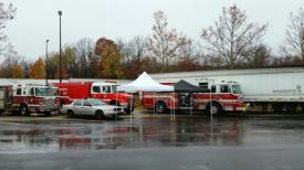 Fire apparatus from Waterbury and Cheshire staged outside of the drill area.